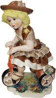 """Статуэтка  Zampiva """"Кукла на велосипеде в светло-коричневом платье"""""""