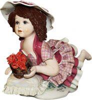 """Статуэтка  Zampiva """"Кукла с цветами лежащая на подушке"""""""