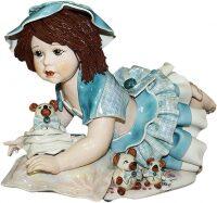 """Статуэтка  Zampiva """"Кукла с медведем лежащая на подушке"""""""